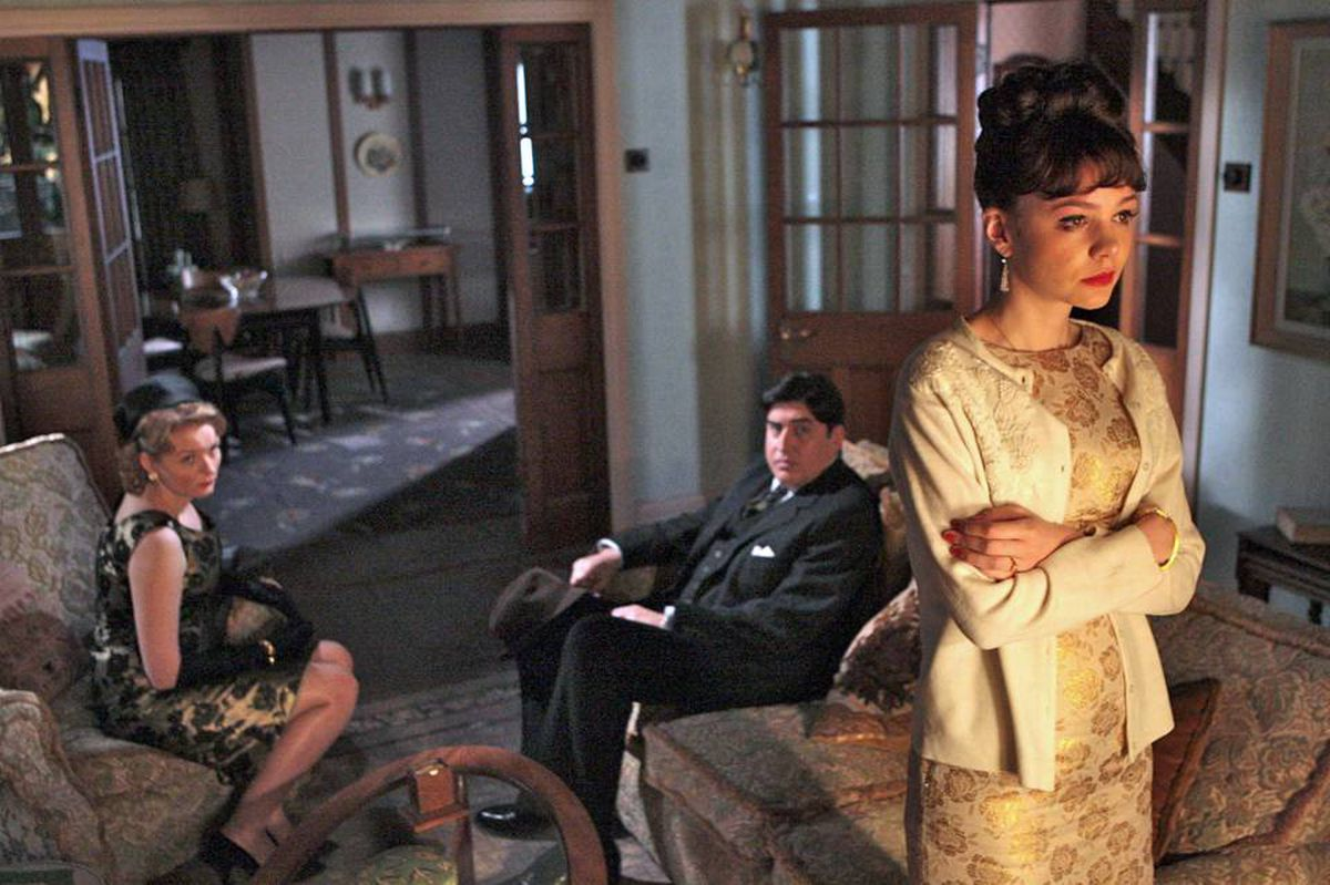Carey Mulligan as Jenny, far right, with Cara Seymour and Alfred Molina as her parents in the background: an appealing coming-of-age story.