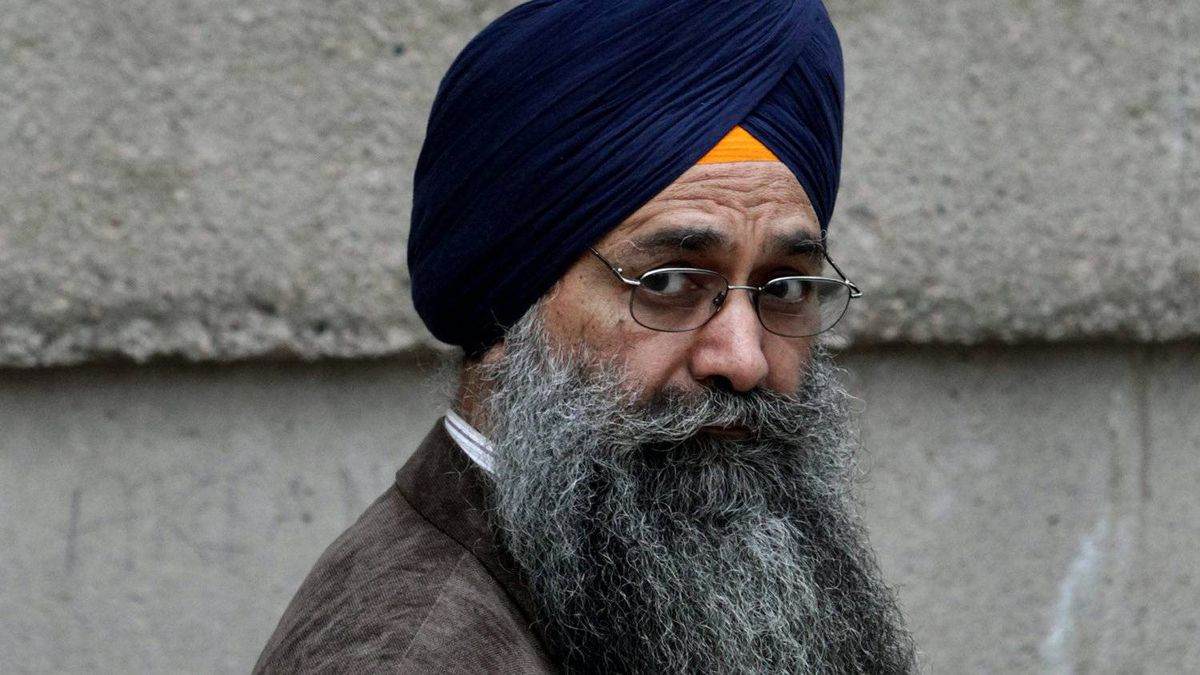 Inderjit Singh Reyat, the only man ever convicted in the Air India bombings of 1985, waits outside B.C. Supreme Court during a fire drill which forced everyone in the building outside prior to the start of the second day of his perjury trial in Vancouver, B.C., on Friday September 10, 2010.