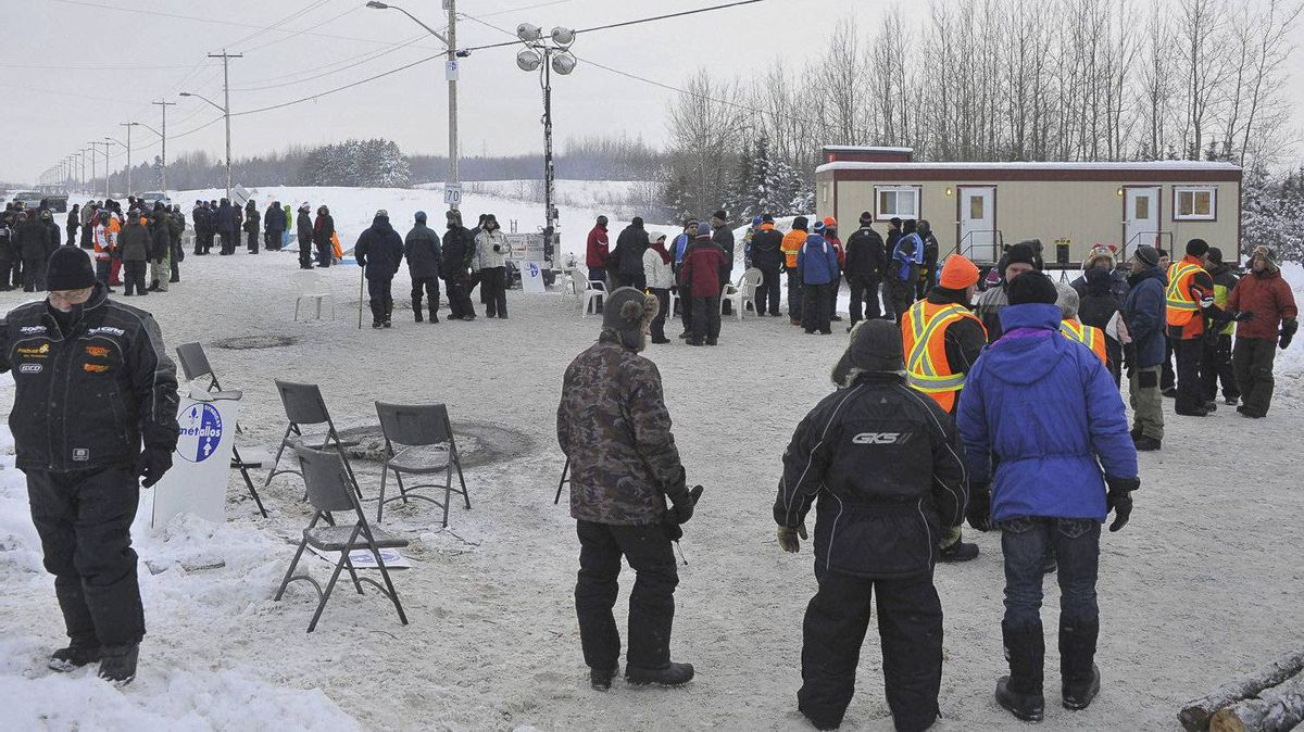 Pickets walk the line at the Rio Tinto Alcan smelter in Alma, Que., after the company locked out workers.