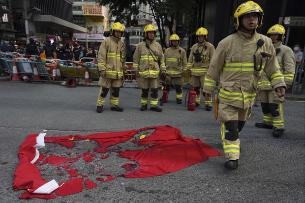 Violence flares between police, protesters after thousands march in downtown Hong Kong
