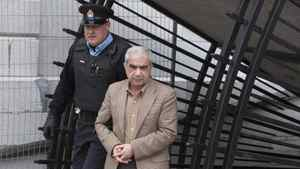 Mohammad Shafia and his son Hamed leave a holding cell following a security concern at the Frontenac County Courthouse in Kingston, Ontario January 26, 2012.
