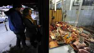 Shoppers check out the meat display at a Kensington Market butcher. Core inflation, which strips out volatile items such as energy and some fresh foods, is expected to accelerate from the current 2.1 per cent to as much as 2.3 per cent, the fastest since 2008.