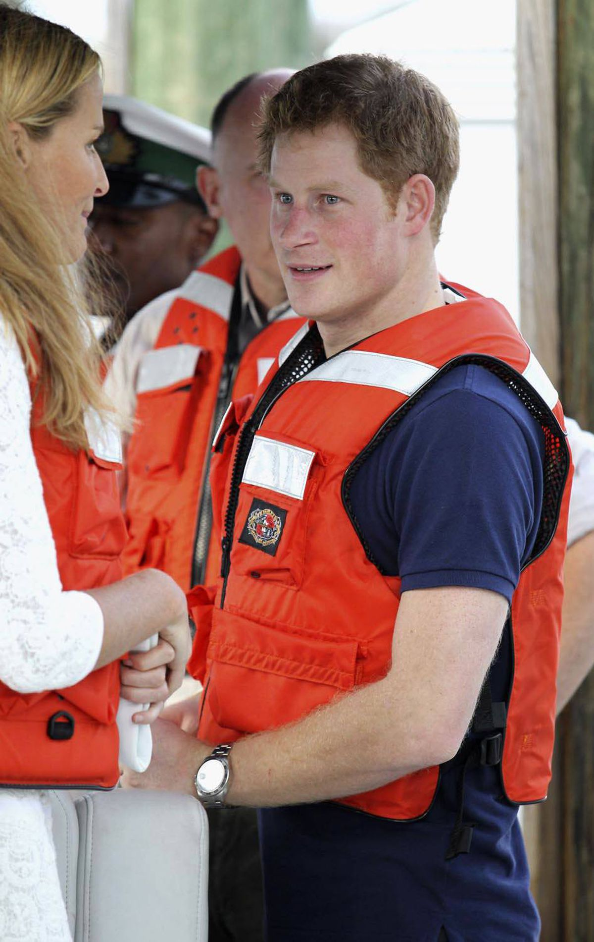 SAFETY CONSCIOUS Britain's Prince Harry talks to family friend India Hicks during a visit to Harbour Island in Nassau, Bahamas, March 4, 2012.