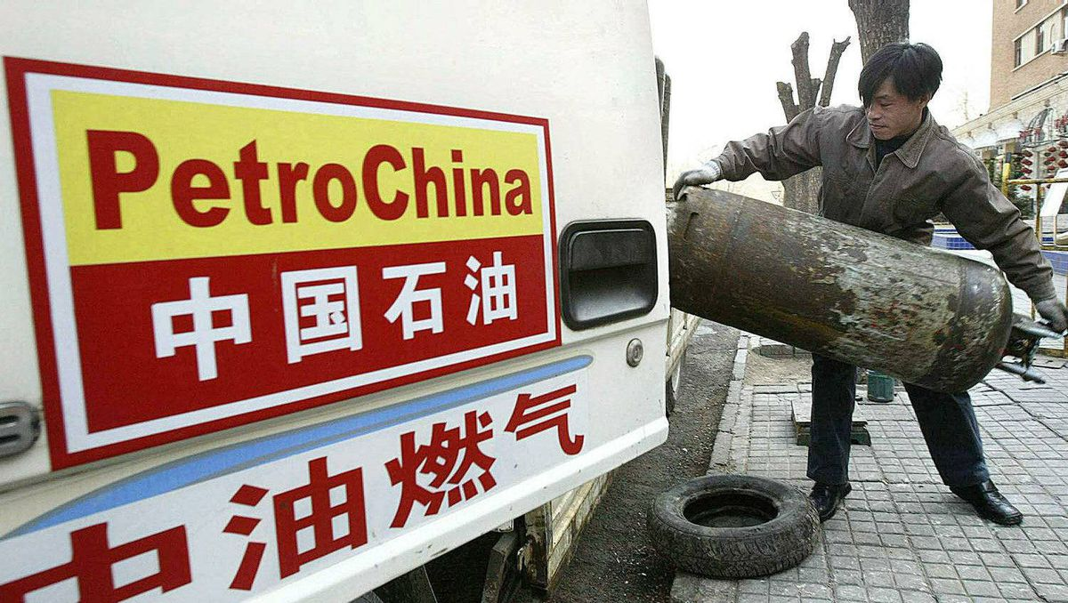 This file photo taken on February 12, 2004 shows a PetroChina worker loading cannisters of liquified petroleum gas (LPG) onto a truck in Beijing.