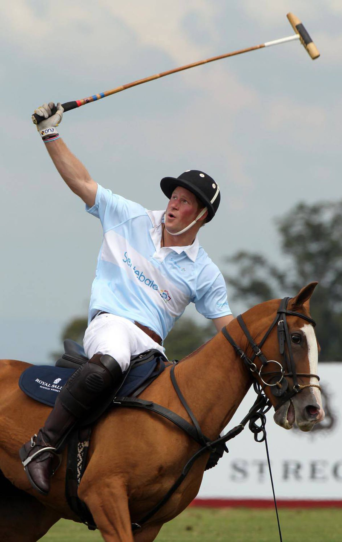 POLO PLAYER Britain's Prince Harry plays a polo match at a farm in Campinas, Brazil, March 11, 2012.
