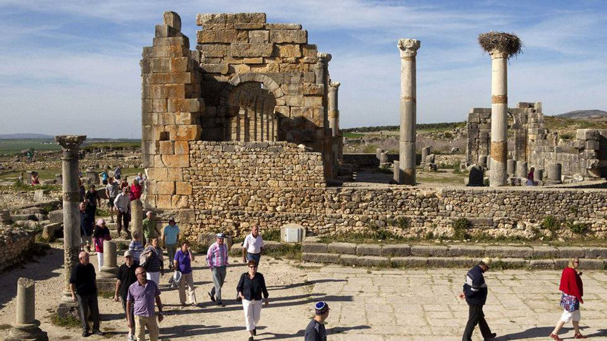 Tourists gather around the arches of the Basilica, the main administrative building of Volubilis, Morocco's most famous Roman ruin, March 8, 2012.