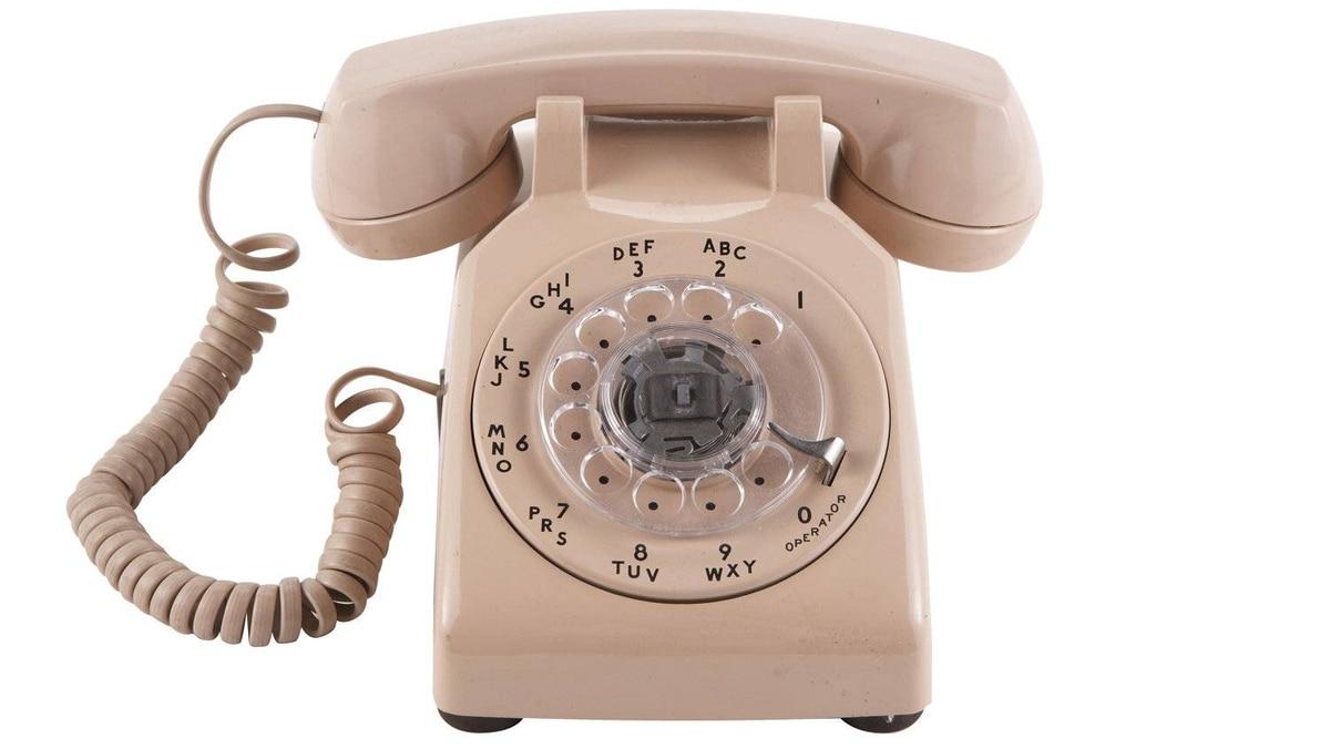 A rotary phone.