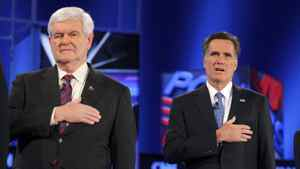 Republican presidential candidates Newt Gingrich, left, and Mitt Romney stand for the U.S. national anthem before the Republican presidential candidates debate in Jacksonville, Fla., on Jan. 26, 2012.