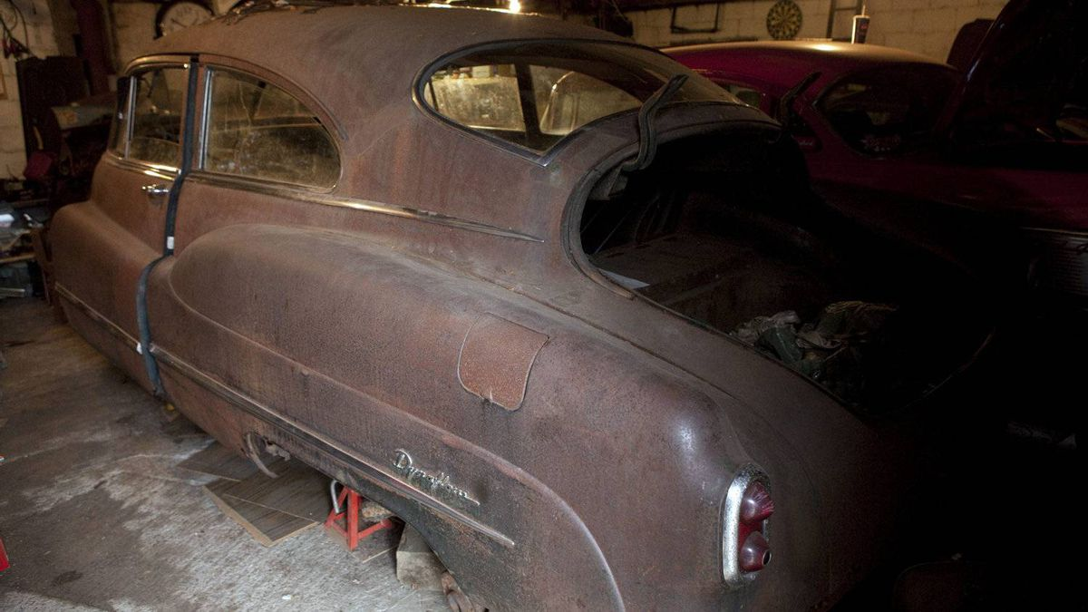 The body of a 1950 Buick Sedanette sits in a garage where Luke Zentil is rebuilding the car.