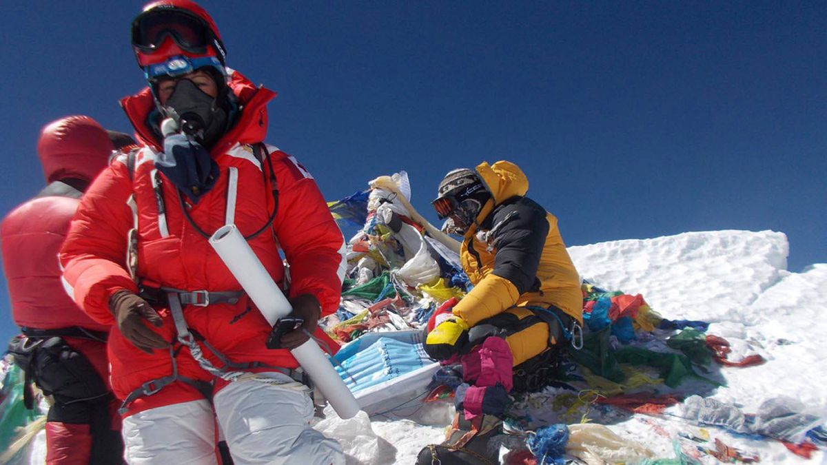 Shriya Shah-Klorfine, foreground, of Toronto, is shown at the summit of Mount Everest on May 19, 2012. She died while returning from the summit.