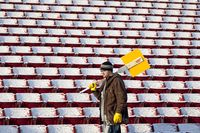 Wax on; wax off: The start of another section as a different worker uses a scraper to clear snow at McMahon Stadium in Calgary, Saturday November 28, 2009. THE CANADIAN PRESS/Adrian Wyld