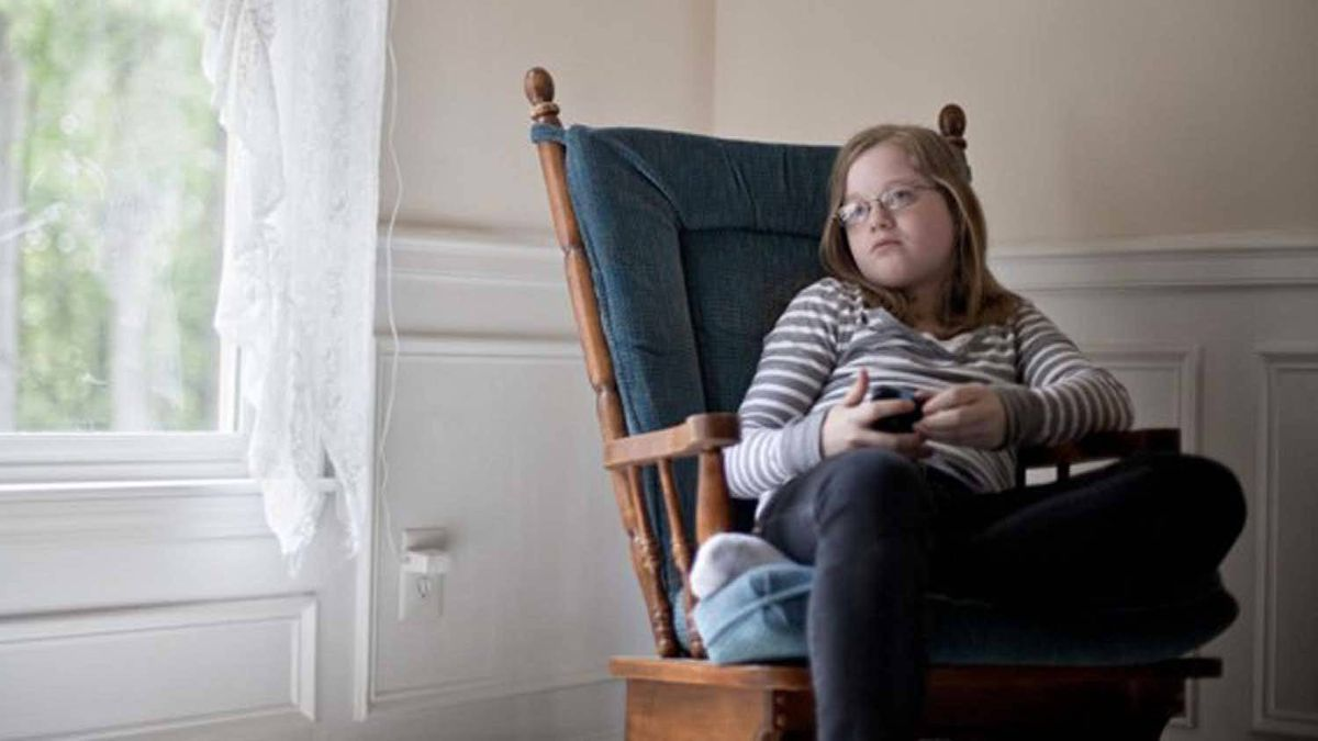 Alexs Boston in her home in Atlanta: Her family is suing two of her schoolmates for libel over a fake Facebook page they created that painted Alex as a racist.