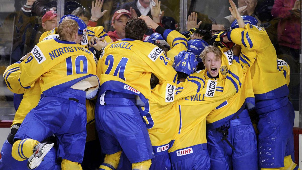 Sweden team members celebrate after defeating Russia in overtime to win the gold medal game of the 2012 IIHF U20 World Junior Hockey Championships in Calgary.
