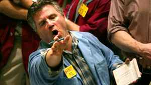 A trader shouts during trading of oil stocks at the New York Mercantile Exchange.