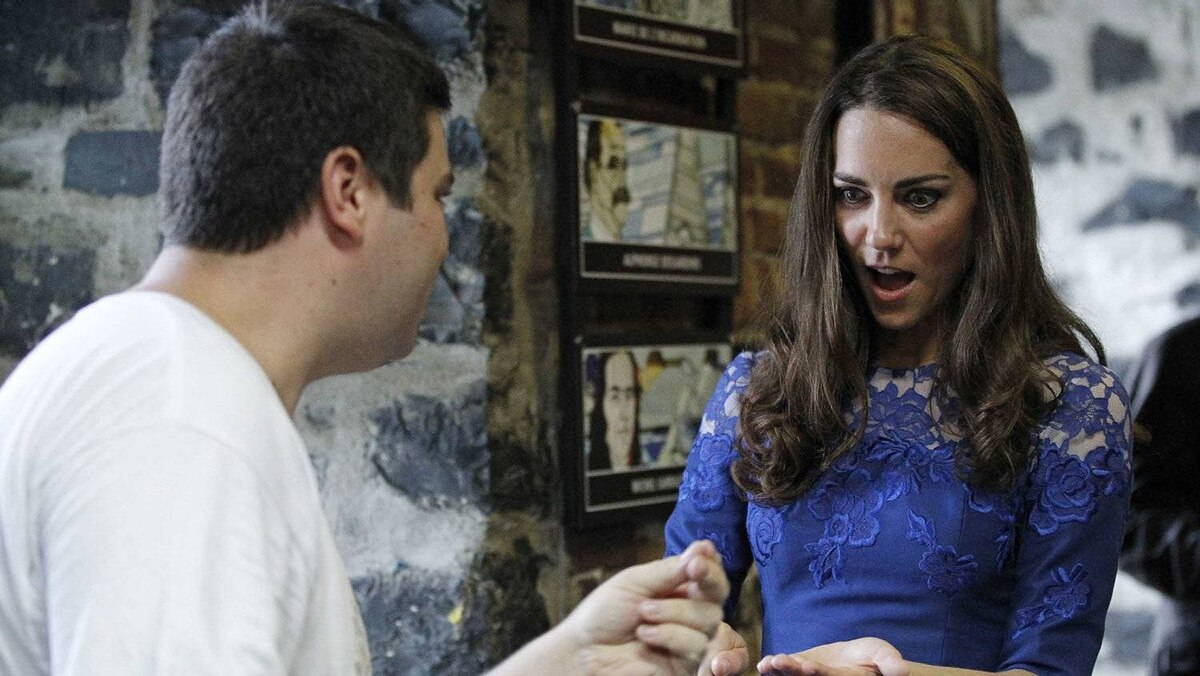 Catherine, Duchess of Cambridge, takes part in a trick during a tour of the Maison Dauphine in Quebec City July 3, 2011.
