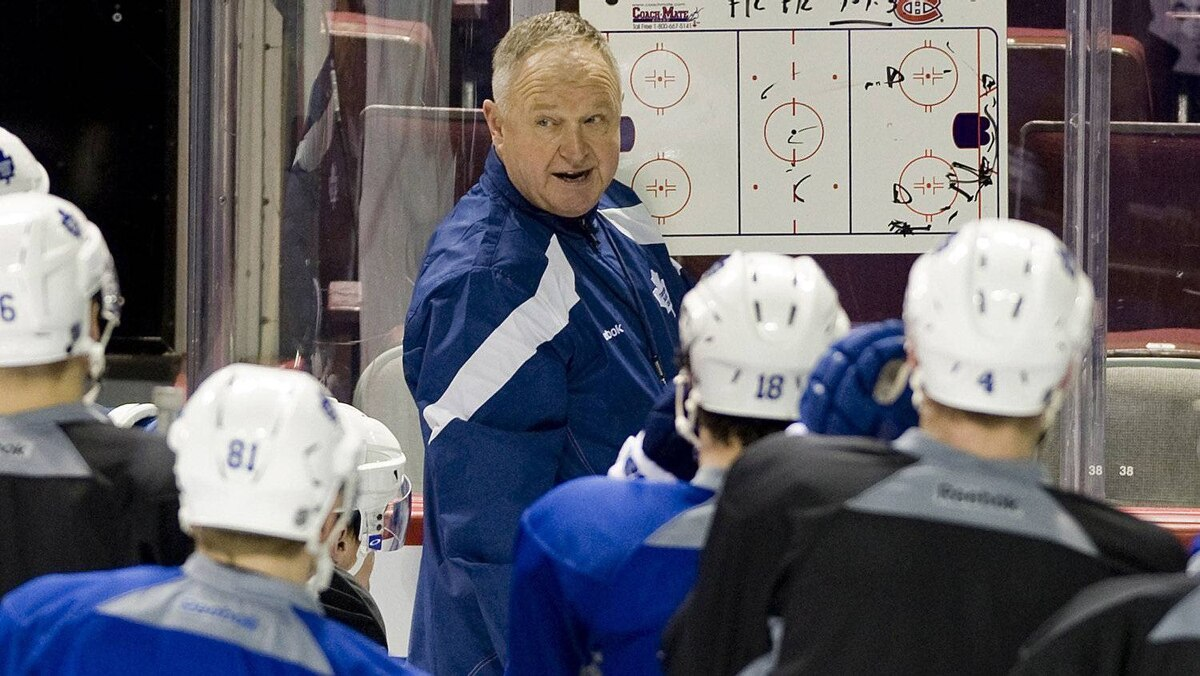 New Toronto Maple Leafs' head coach speaks to players during a practice session at the Bell Centre in Montreal, March 3, 2012.
