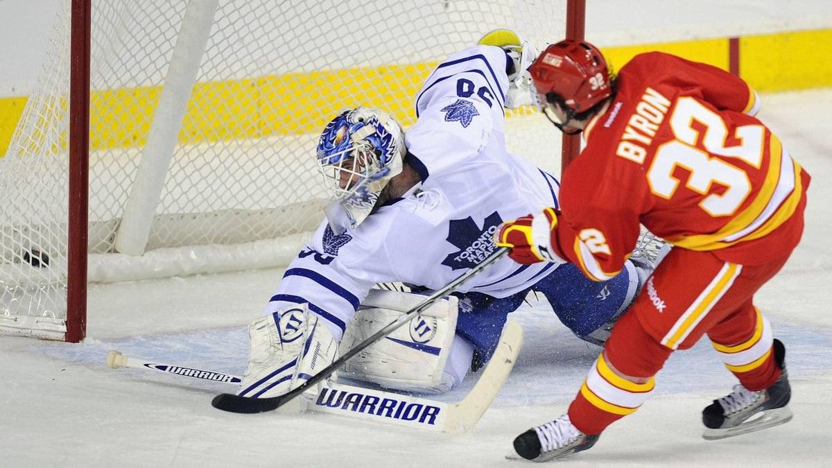 The Calgary Flames' Paul Byron scores on Toronto Maple Leafs' goalie Jonas Gustavsson on a penalty shot in Calgary, Feb. 14, 2012.