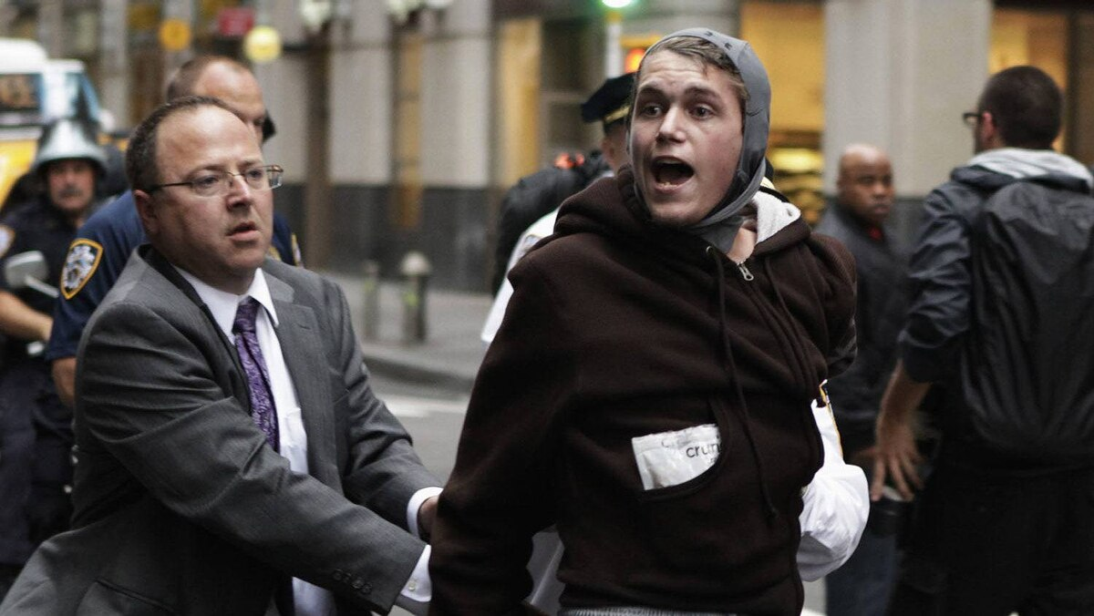 New York Police Department officers arrest a member of the Occupy Wall Street movement during a march through the financial district of New York October 14, 2011.