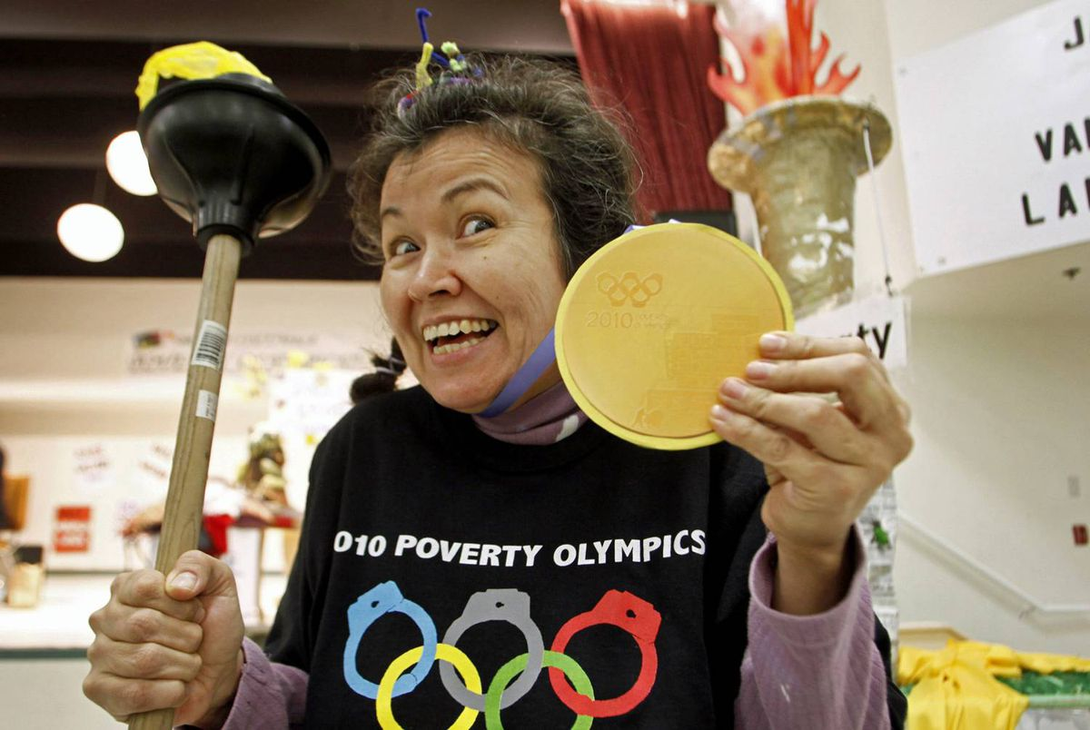 Muriel Marjorie shows off her gold medal during the Poverty Olympics, held to protest against the amount of money spent on the Winter Games, on Feb. 7, 2010 in Vancouver.