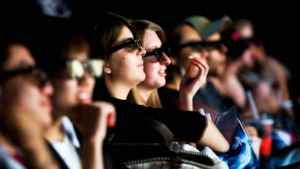 Movie goers watch Ice Age: Dawn of the Dinosaurs 3D at Scotiabank Theatre at in Toronto on July 2, 2009.