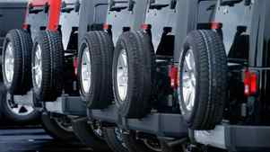 In this photo taken July 24, 2011, new Jeeps are lined up for sale at an Chrysler dealership in Springfield, Ill.