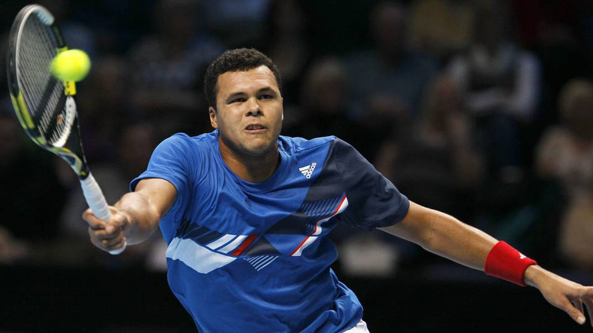 Jo-Wilfried Tsonga of France plays a return to Mardy Fish of the U.S. during their round robin singles match at the ATP World Tour Finals.