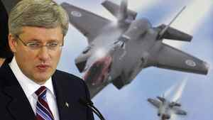 Prime Minister Stephen Harper visits a Waterloo, Ont, plant that manufactures accessories for the F-35 fighter jet on March 11, 2011.