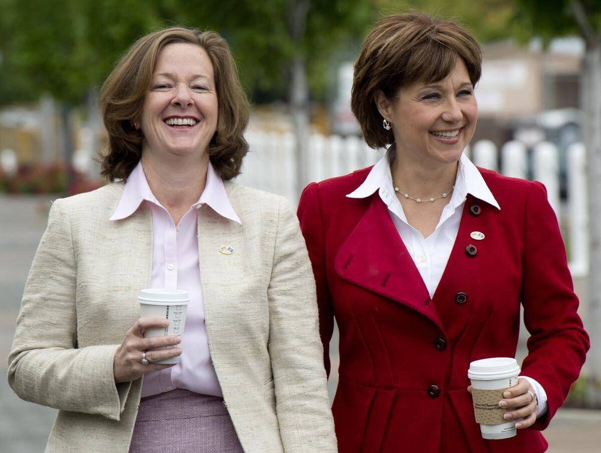 British Columbia Premier Christy Clark, right, and Alberta Premier Alison Redford are seen prior to a closed door meeting in Kelowna, B.C. Friday, June 14, 2013.
