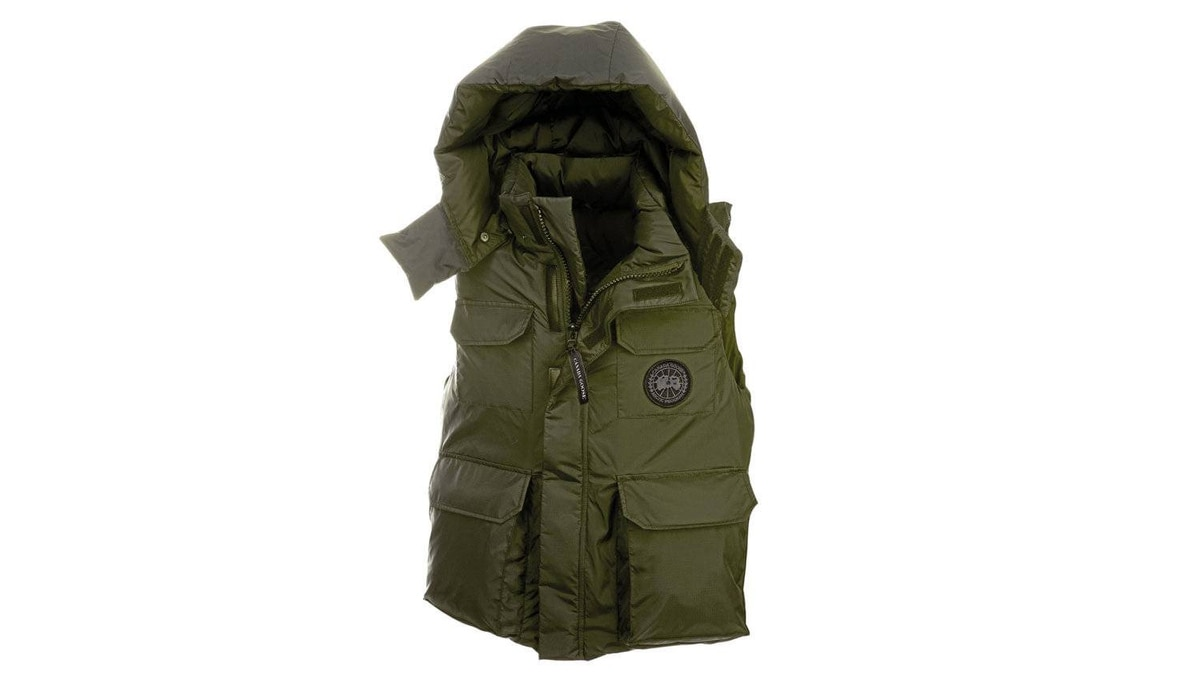 NORTH Keep warm north of 60 in the Canada Goose Alberta Vest. This hip-length down-filled vest is built for winter, but the slim fit and removable hood make it versatile enough to suit cool sub-Arctic conditions all year-round. Multiple internal and external pockets allow for plenty of storage space and a heavy-duty storm flap protects against high winds and wetness. $425