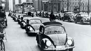 Picture taken in 1938 shows the first Beetles of the preproduction series VW 38 in front of Berlin's Brandenburg Gate.