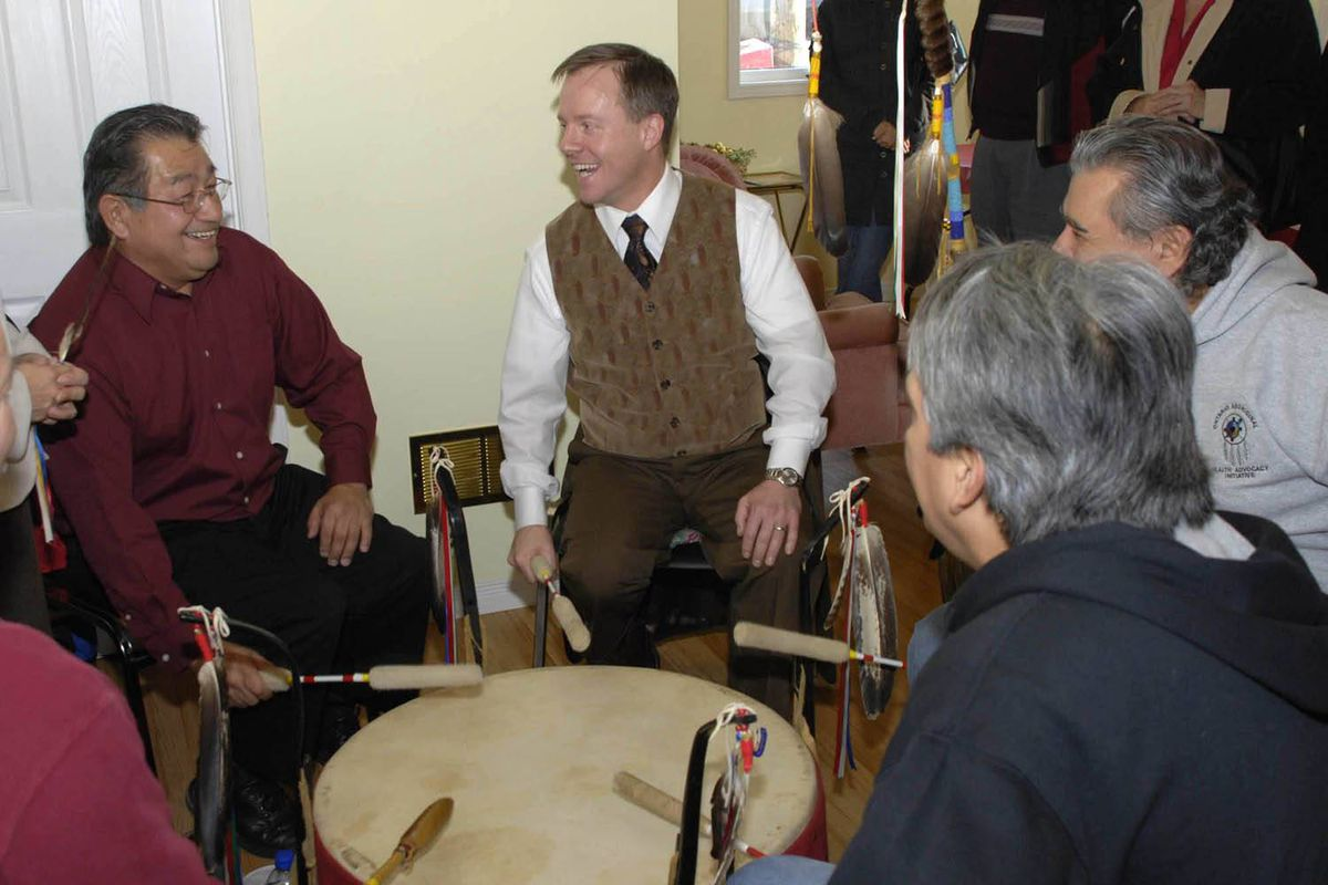 Michael Bryant with Sam George, the brother of the late Dudley George, when Mr. Bryant was the Minister of Aboriginal Affairs at a a drumming circle at Kettle and Stony Point reserve.