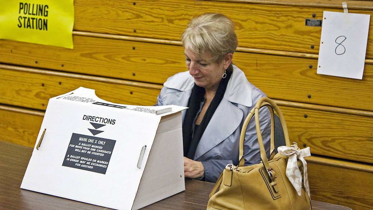 Progressive Conservative Leader Kathy Dunderdale casts her ballot in Newfoundland and Labrador's election at a St. John's polling station on Oct. 11, 2011.