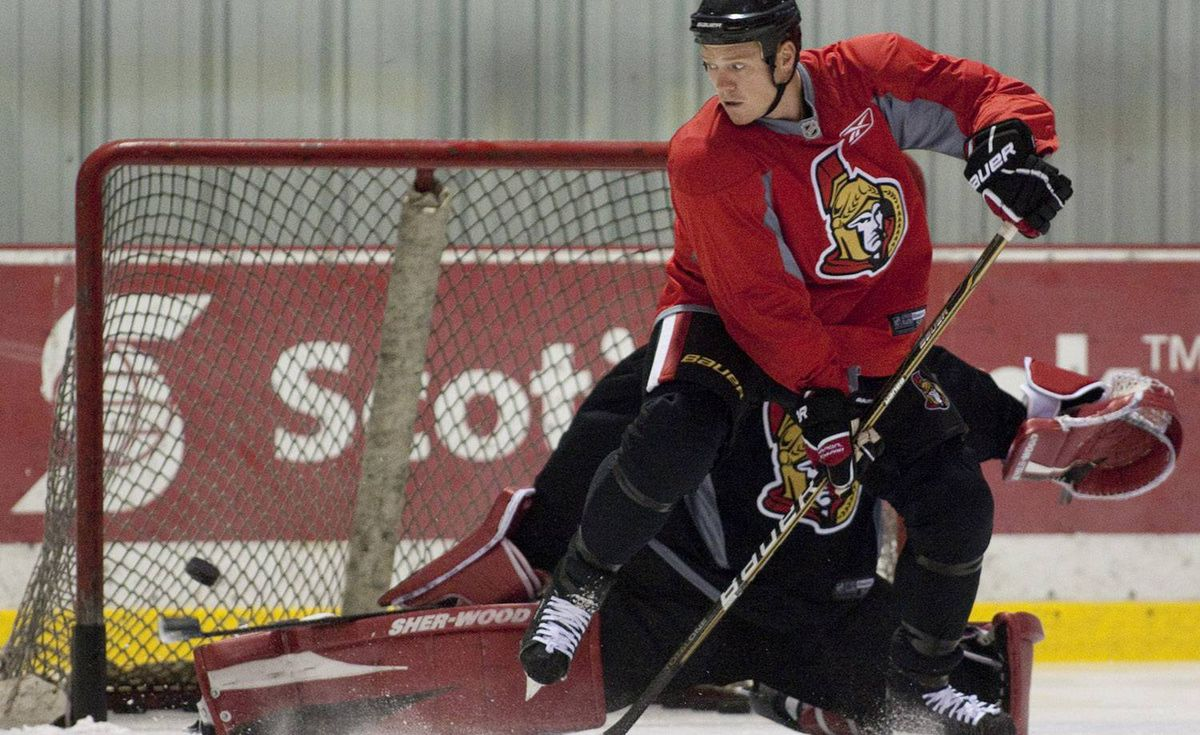 Ottawa Senators Chris Neil deflects the puck pas goaltender Pascal Leclaire during a team practice in Ottawa on Wednesday, October 6, 2010. Pawel Dwulit for the Globe and Mail