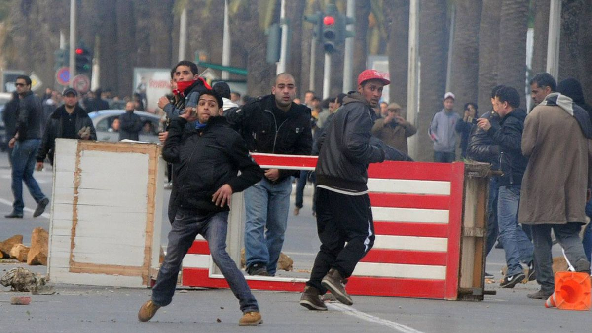 A Tunisian demonstrator throws a rock during clashes with security forces on Mohamed V avenue in Tunisia on Jan. 14, 2011 after Tunisian President Zine El Abidine Ben Ali's address to the nation.