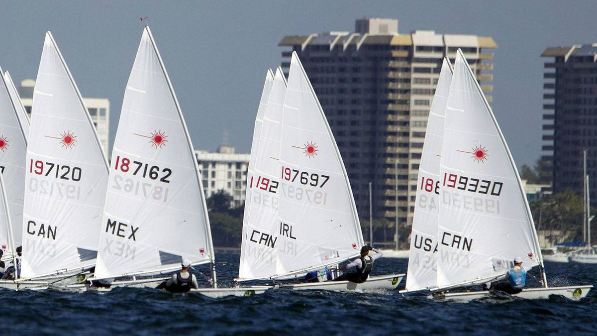 A group of Laser class boats begin their race at the Miami Olympic Classes Regatta on Biscayne Bay in Miami, Wednesday, Jan. 25, 2012. More than 500 sailors from 44 countries are competing in the stepping stone to the Olympic games.(AP Photo/J Pat Carter)