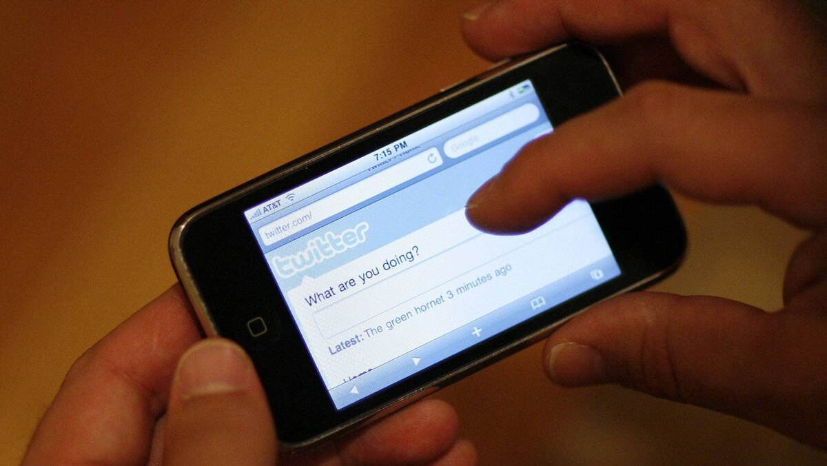 A Twitter page is displayed on an Apple iPhone in Los Angeles October 13, 2009.