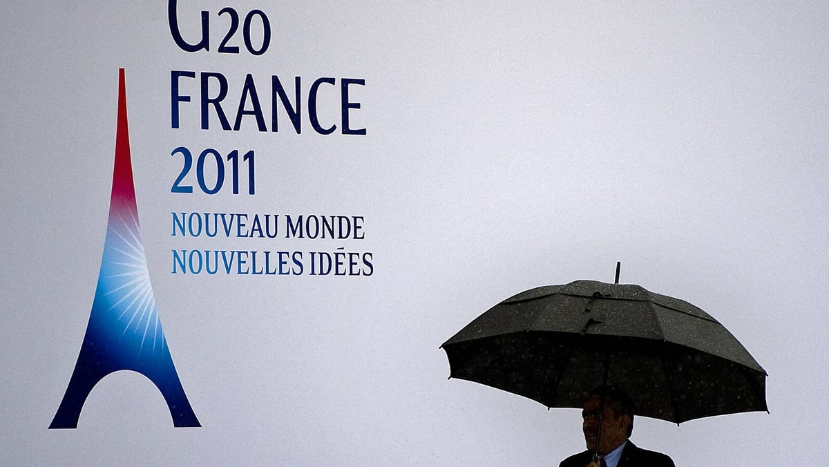 A delegate holds an umbrella as heavy rain hits Cannes, France, at the beginning of the G20 summit on Nov. 3, 2011.