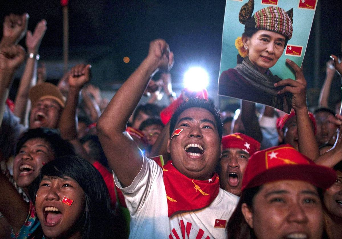National League for Democracy (NLD) supporters celebrate outside the NLD headquarters as they watch results come in for the by-elections in Yangon, Myanmar on Apr. 1, 2012.