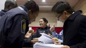 Job Seekers visit the Canadian Border Service Agency stand at the Bi-lingual Job Fair and Training Expo in Toronto on Thursday March 8, 2012 .