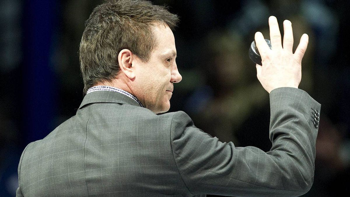 Hockey Hall of Fame inductee Doug Gilmour waves as he takes part in a ceremony before the Toronto Maple Leafs take on the Ottawa Senators in NHL hockey action in Toronto on Saturday, Nov. 12, 2011. THE CANADIAN PRESS/Nathan Denette
