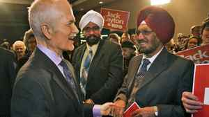 NDP Leader Jack Layton is greeted by supporters at a campaign stop in Surrey, B.C., on March 27, 2011.