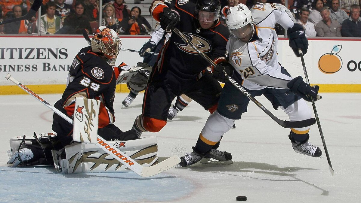 Goaltender Ray Emery #29 of the Anaheim Ducks defends his net as teammate Toni Lydman #32 battles with Joel Ward #29 of the Nashville Predators for the puck. (Photo by Jeff Gross/Getty Images)