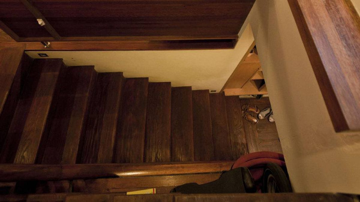 The stairs and cabinets in Poon's apartment, located at the end of a traditional lane, are made from locally reclaimed wood