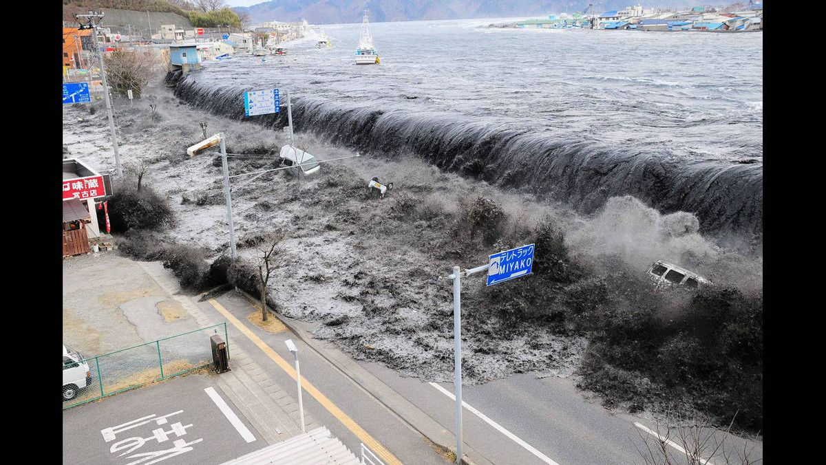 A tsunami floods over the breakwater protecting the coastal city of Miyako at Heigawa estuary area after northeastern Japan was hit by a powerful earthquake March 11, 2011.