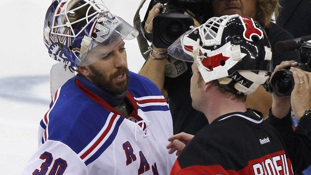 New York Rangers goalie Henrik Lundqvist (L) congratulates New Jersey Devils goalie Martin Brodeur after the Devils defeated the Rangers in Game 6 of their NHL Eastern Conference Final game in Newark, New Jersey, May 25, 2012.