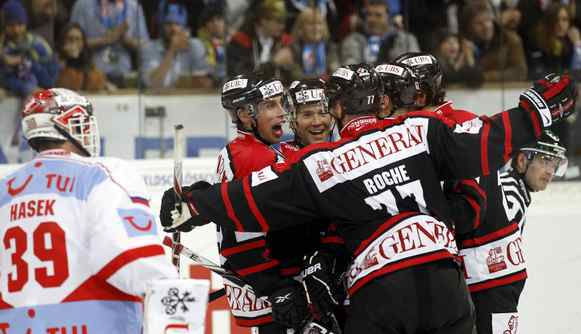 Team Canada's Micki Dupont (3rd L) and his teammates celebrate as goalkeeper Dominik Hasek (L) of Spartak Moscow stands beside after Dupont scored during their ice hockey match at the Spengler Cup tournament in the Swiss mountain resort of Davos December 27, 2010.
