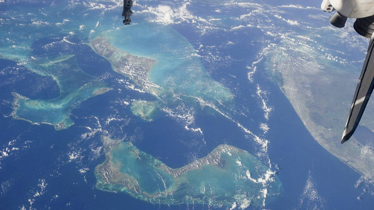 """In this image provided by NASA the """"Tongue of the Ocean"""" and several of the 2700 islands in the Bahamas chain and part of peninsular Florida, at right, including Cape Canaveral, the location of the Kennedy Space Center, are easily recognized in this scene photographed by one of the STS-135 crewmembers while Atlantis was docked with the International Space Station Tuesday July 12, 2011."""
