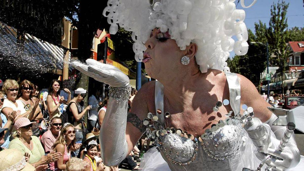 A drag queen blows fairy dust into the crowd during the Gay Pride Parade in Vancouver, Sunday, August 5, 2007. (