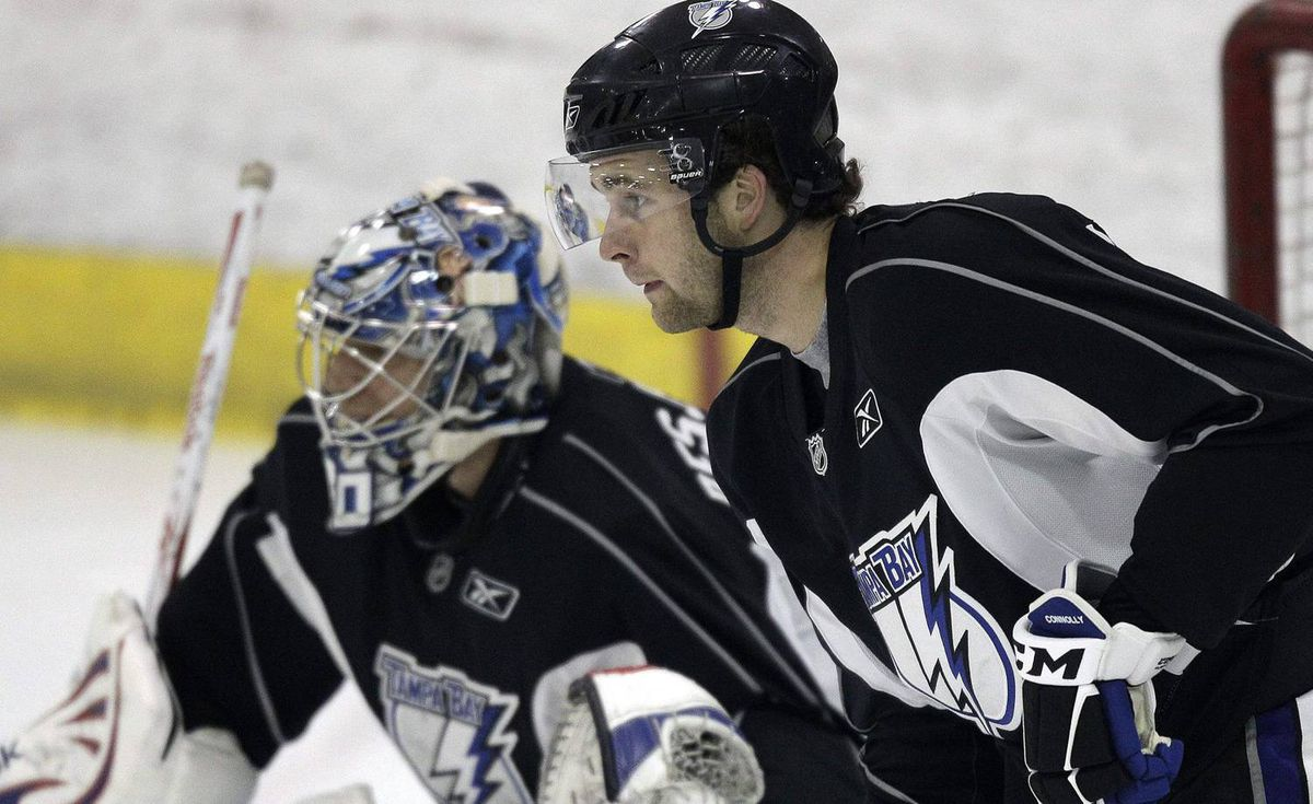 Tampa Bay Lightning first round draft pick Brett Connolly, right, looks for a pass in front of goaltender Cedrick Desjardins during the first day of NHL hockey training camp Saturday, Sept. 18, 2010, in Brandon, Fla. (AP Photo/Chris O'Meara)