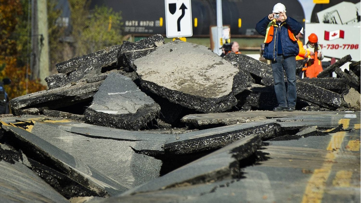 A large sinkhole closed a section of Bayview Avenue just north of Steeles Avenue as crews worked to repair the damage in Toronto, Ont. Nov. 3, 2011.